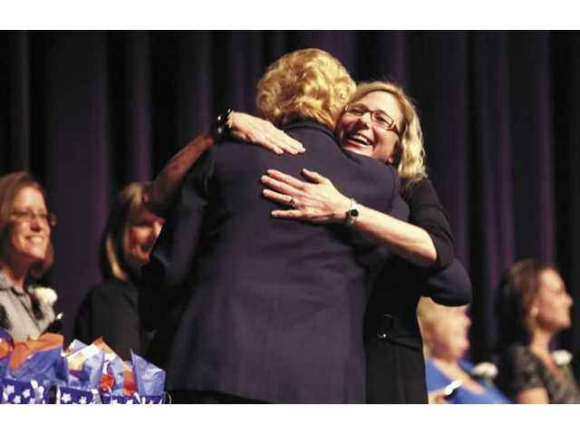 Skyblue Mesa Elementary School teacher Virginia Terracciano receives a hug after garnering an award during the 2008 Teacher Tribute held Thursday night at the College of the Canyons' Performing Arts Center.