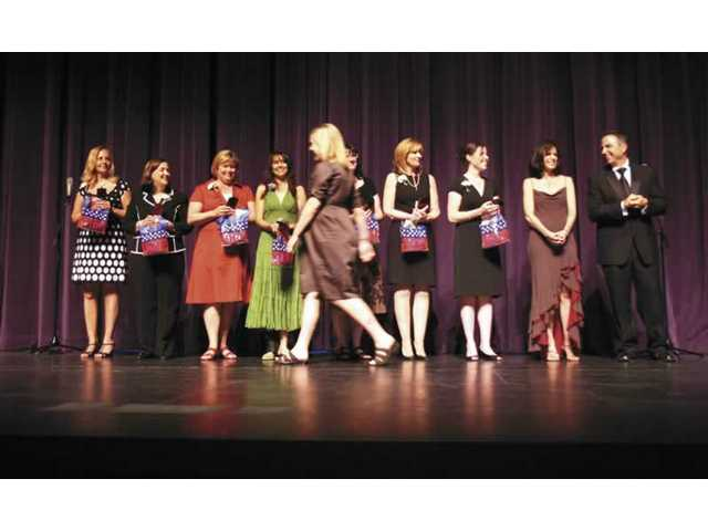 Newhall School District teachers line up on stage as their names are announced during the tribute.