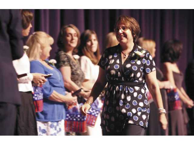 Santa Clarita Elementary teacher Shari Lewis passes fellow Saugus Union School District colleagues who were also  recognized during the tribute.