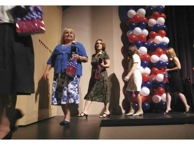 Saugus Union School District teachers leave the stage after being honored during the tribute.