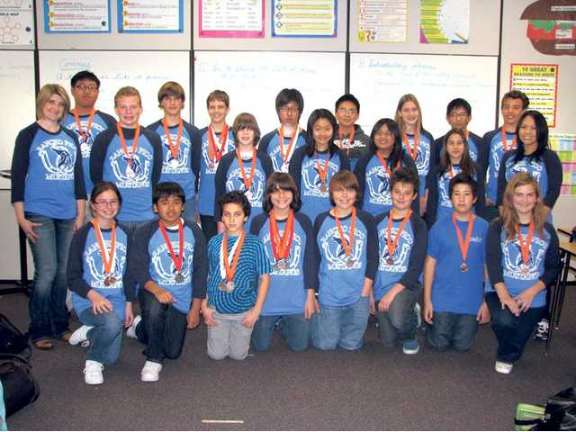 Rancho Pico Junior High School's Science Olympiad team shows off its medals won during the 23rd regional Science Olympiad competition.