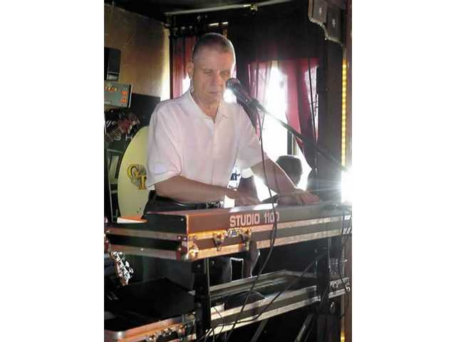 Jay Spell, a 62-year-old blind keyboardist who survived esophageal cancer, performs at The Londoner Pub on Sunday.