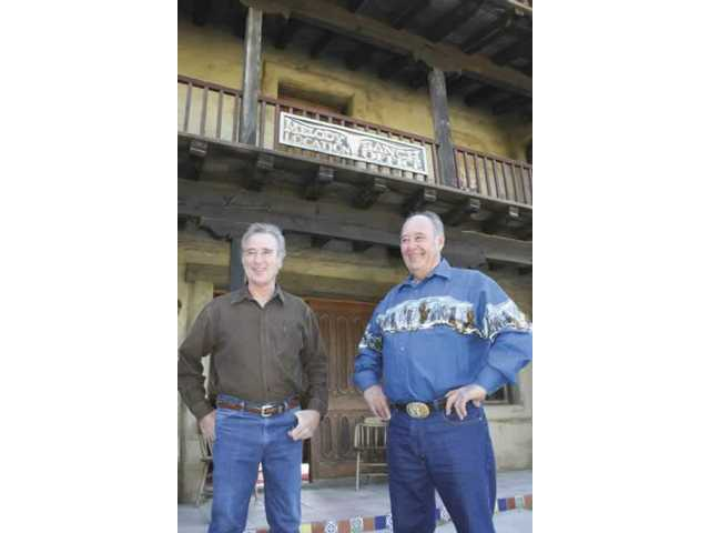 Melody Ranch owners Andre and Renaud Veluzat pause on the steps of their production office before heading over to nearby Main Street.