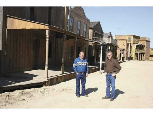 Andre and Renaud Veluzat take a stroll down the freshly refurbished Main Street at Melody Ranch. The otherwise deserted set seemed surreal. In a week, thousands of western fans will pack the street for the 2008 Santa Clarita Cowboy Festival.