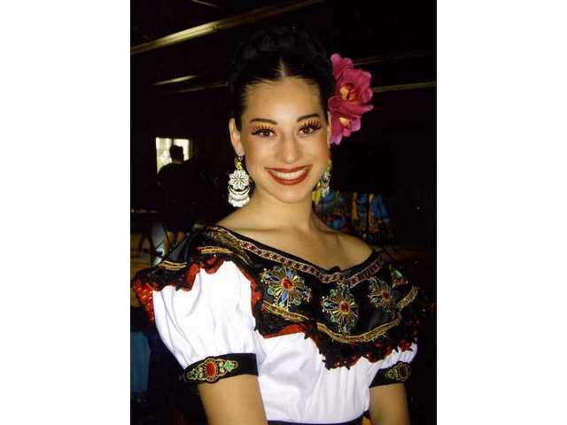 "Cristina Romero, 16, blends Irish and Folklorico choreography in ""La Flor de Maiz."""
