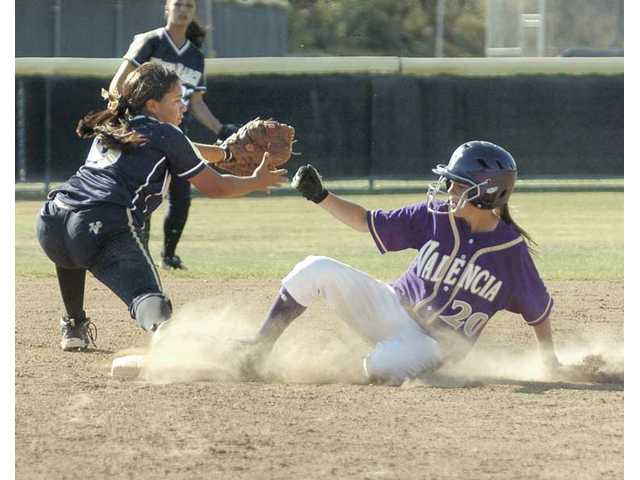 Valencia's Melissa Fundoro (20) slides into second base as West Ranch's Breanna Satiago takes the throw Tuesday at Valencia High.