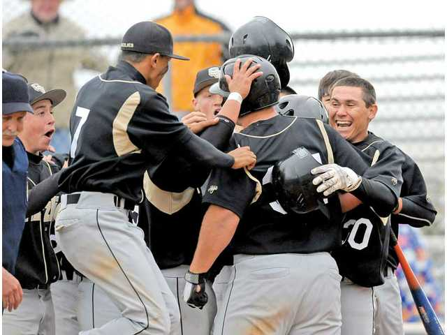 Golden Valley's Brandon Smith celebrates his seventh-inning home run with his teammates at home plate.