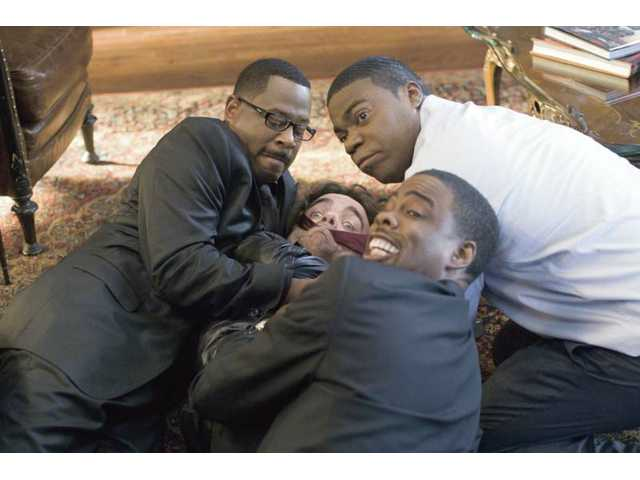 "Clockwise from left, Martin Lawrence, Tracy Morgan, Chris Rock and Peter Dinklage in ""Death at a Funeral."""