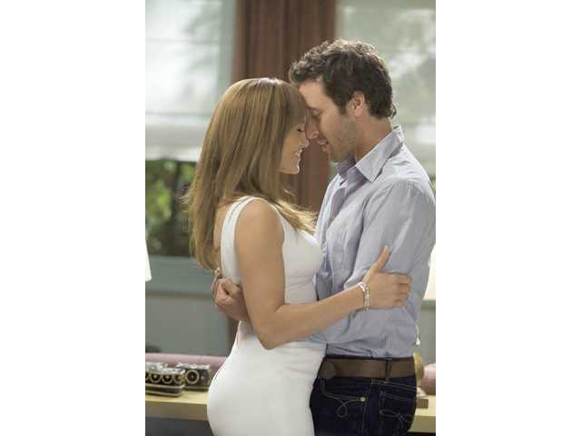 "Jennifer Lopez, left and Alex O'Loughlin are shown in a scene from, ""The Back-Up Plan."""