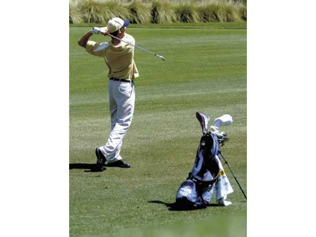 West Ranch's Ryan Weltig watches his shot off the fifth tee Tuesday at TPC Valencia.