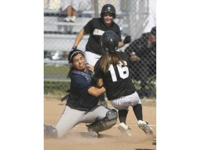 Saugus catcher Alexis Tellez blocks the plate as Golden Valley's Amber Jensen March collides with her Tuesday.
