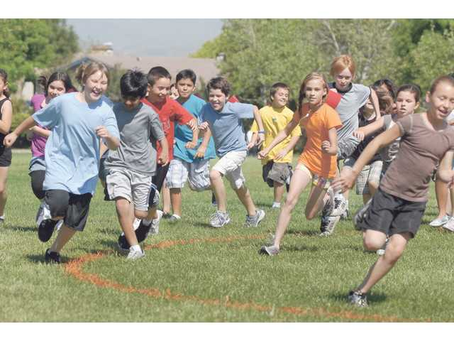 The fourth-graders of Lisa Carr's class, Carr's California Cougars, start running their laps at the Tri-R-athon fundraiser at Valencia Valley Elementary School on Wednesday to raise money for computer equipment for the school. The students raised more than $15,000 to help purchase equipment for the school's classrooms.