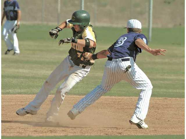 Saugus shortstop Zach Vincej (3) makes the tag on Canyon's Kyle Pressman during the fourth inning Wednesday at Saugus High School.