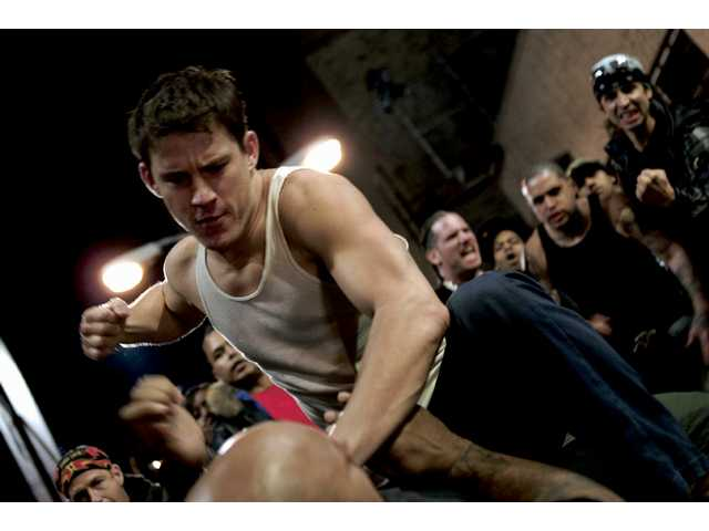 "Channing Tatum in a scene from ""Fighting,"" which earned three stars from film critic Roger Ebert."
