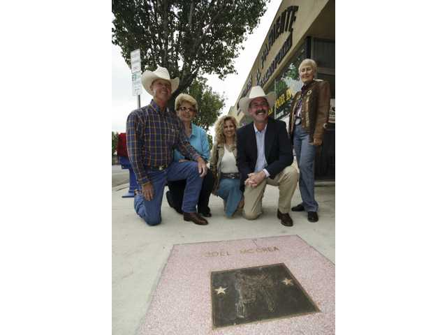 David McCrea, Lauralea McCrea, Lisa McCrea, Wyatt McCrea and City Councilwoman Laurene Weste pose for photos next to the plaque honoring late film legend Joel McCrea, Friday afternoon in downtown Newhall.