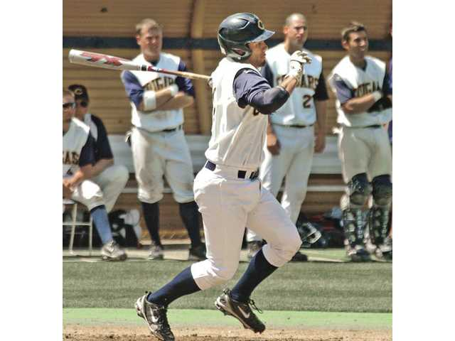 College of the Canyons first baseman Hugo Hernandez hits an RBI single against Glendale College on Saturday at COC.