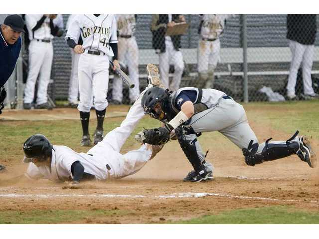 West Ranch catcher Max Blaha tags out Grizzly Alex Dagg at home plate Friday at Golden Valley. The Wildcats beat the Grizzlies 14-3.