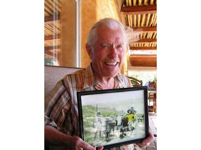 In April 2005, stunt legend Jack Williams of Agua Dulce shows a hand-colored black and white photo of his father George and mother Paris, and Jack as a youngster, taken at the old Bonnelli Ranch -- now Saugus Speedway.