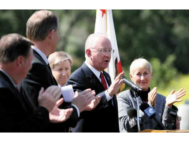 "At a Friday morning news conference outside his Valencia offices, Congressman Howard P. ""Buck"" McKeon announced an agreement has been reached that could end an 8-year dispute between the city of Santa Clarita and Cemex over a planned mine in Soledad Canyon."