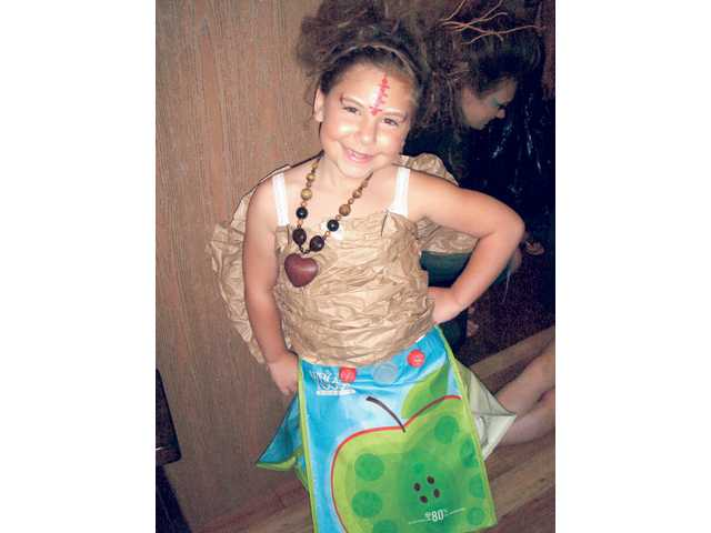 Chloe Sawyer, 9, modeled a skirt made of shopping bags from Whole Foods Market in Valencia. Around her neck was a hand crafted necklace from designer, Jayme Lindberg, whose jewelry and accessories from Indonesia were presented on most of the models.