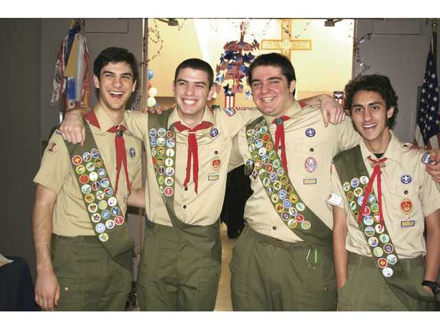 A flock of new Eagle Scouts. Left to right, Michael Morris, Gabriel Sayegh, Neil Subbarao and John Morris.