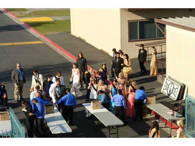 Valencia students go through a security check before boarding charter buses to the Gene Autry Museum on Saturday, April 24 at Valencia High School.