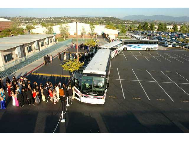 Valencia High School students board charter buses to the Gene Autry Museum on Saturday, April 24, for prom night.