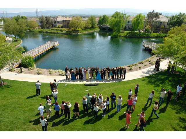 Valencia High School students, parents and friends celebrate the moment in front of Bridgeport Lake on Saturday, April 24.