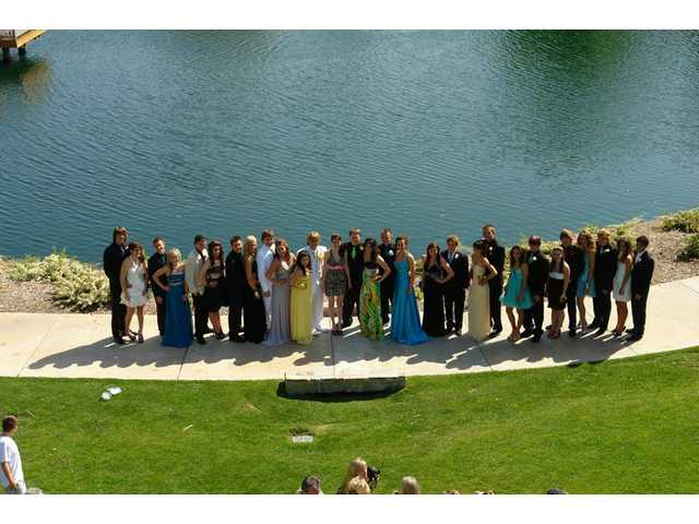 Twenty-nine Valencia High School sudents and friends pose for cameras in front of Bridgeport Lake on Saturday, April 24, before attending senior prom at Gene Autry Museum in Los Angeles.