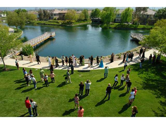 Valencia High School students, parents and friends take pictures in front of Bridgeport Lake on Saturday, April 24, before prom.