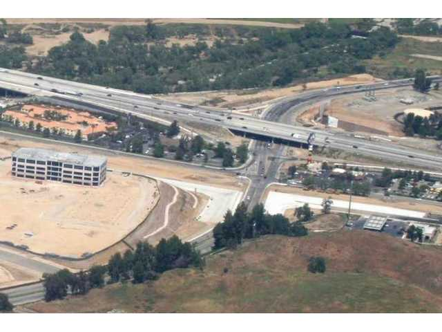 Viewed looking east-northeast, the intersection of The Old Road at Magic Mountain Parkway just west of Interstate 5 averaged more than 24,942 vehicles per day during peak hoursbetween 2003 and 2007.