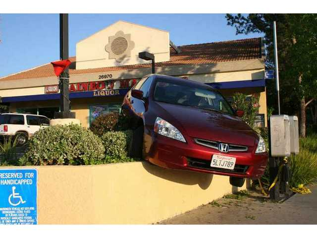 Off the wall: A driver hit the gas instead of the brake in a Canyon Country parking lot Saturday and drove her car partially off the wall.