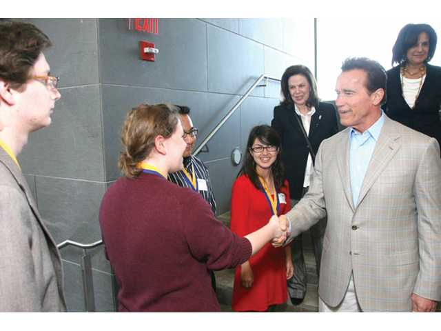 Hart High School junior Hanna Stern (second from left), 2000 California State Summer School for the Arts alumni and winner of a $2,500 Herb Alpert Scholarship for Emerging Young Artists Award in Creative Writing, shakes hands with Gov. Arnold Schwarzenegger on Friday. Schwarzenegger honored California State Summer School for the Arts alumni with the governor's medallion at the Broad Stage in Santa Monica.