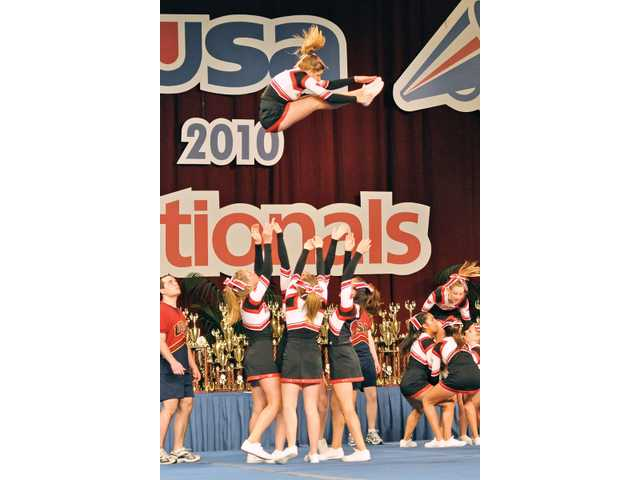 The Hart cheerleaders perform a high-flying stunt. Their stunt group won first in the Group Stunt Advanced Division.