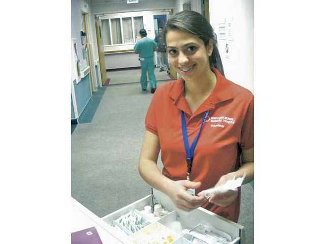 Kathryn Rieck volunteers in the hospital pharmacy, where she sorts medications and transports prescriptions to nurses' stations.