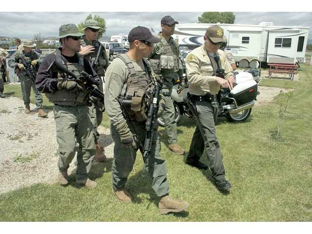 LA County Sheriff's swat team members prepare to search a portion of the Santa Clara riverbed near the Valencia Travel Village in Castaic, where shoe prints matching those worn by two escapees from the Pitchess Detention Center were found on Wednesday.