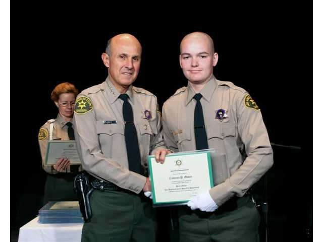 Cameron Glover (right), pictured with Los Angeles County Sheriff Lee Baca, graduated with Los Angeles County Sheriff's Academy class No. 354 on Jan. 19, 2007. Glover died Wednesday night in a motorcycle crash.