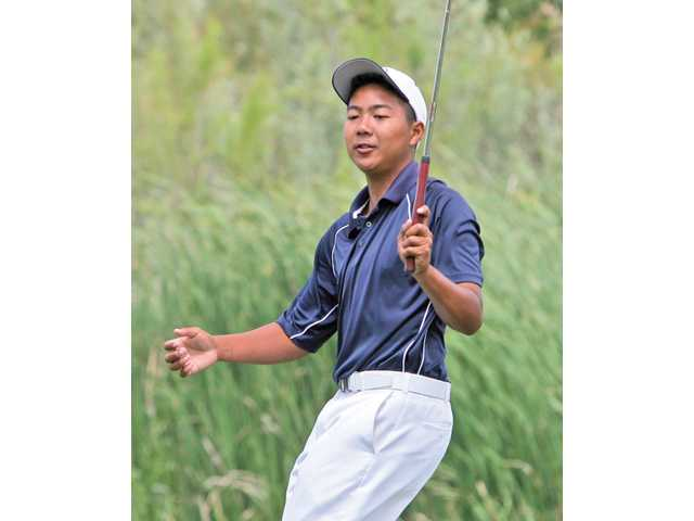 C.J. Espino of West Ranch, which won the team title, watches his putt Wednesday.