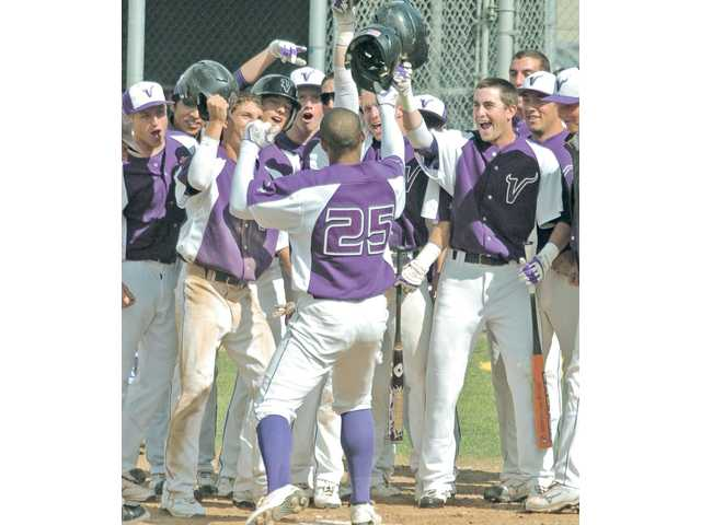 Valencia's Trey Williams (25) is congratulated by teammates after hitting a home run on Wednesday at West Ranch High.
