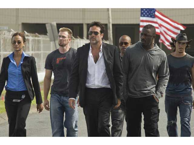 "From left, Zoe Saldana, Chris Evans, Jeffrey Dean Morgan, Columbus Short, Idris Elba and Oscar Jaenada are shown in a scene from, ""The Losers."" The line at the concession stand probably has more tension."