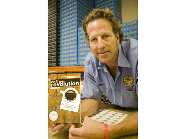 "Mitch McMullen, owner of Newhall Coffee Roasting Company, recently published ""Coffee Revolution."" In his book, McMullen sheds light on how his small company survives against big corporate competitors. The local entrepreneur is also using Twitter, Facebook, and other Web related mediums to stay connected with clients."