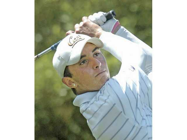Valencia's Max Homa follows the ball after hitting his tee shot on the ninth hole