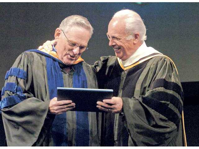 Dr. John MacArthur, president of The Master's College, right, presents a Faculty Service award to John Stead, a professor of history and political science, for his 40 years of service to the college at Baccalaureate Chapel ceremonies on April 28.