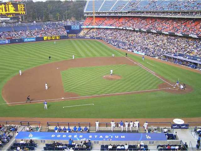 A wide-screen view from the club level at Dodgers Stadium. Watching the game is the No. 1 fan attraction.
