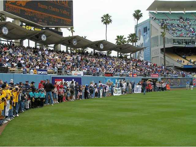 SCV Dodger Day celebrated its 31st year in 2008; it's one of Dodger Stadium's largest annual community salutes. The SCV Youth Parade walks on the outfield's warning track, under the DodgerVision screen flashing a welcome to them.