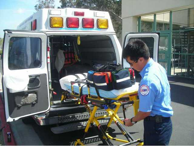 Local E.M.T. Eric Hisey readjusts a gurney in preparation for his next emergency call. Hisey began working for American Medical Response in Santa Clarita after recovering from a critical neck injury he suffered in September 2006, while surfing in Zuma Beach.