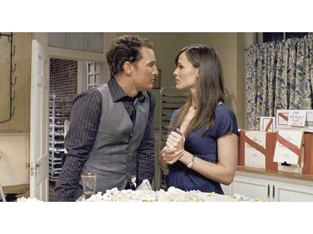"Matthew McConaughey, left, and Jennifer Garner are shown in a scene from ""Ghosts of Girlfriends Past."""