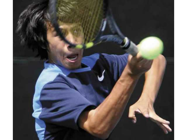 West Ranch's Jeremy Ramirez hits a volley in a doubles match at the boys tennis preliminaries at the Paseo Club Wednesday.