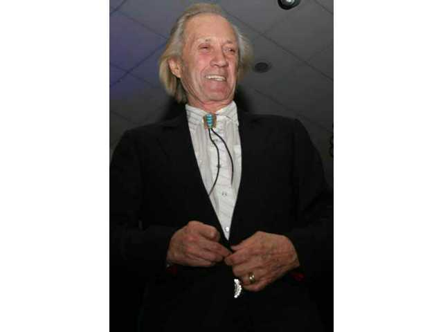 At the Walk of Western Stars induction dinner Friday night at the Hyatt, David Carradine leaves the stage smiling after regaling the audience with behind-the-scenes stories about his career.