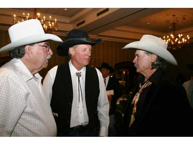 Honoree Jack Lilley (left) and presenter Bruce Boxleitner swap a story with Buck Taylor, artist who created the official poster for the 2008 Santa Clarita Cowboy Festival.
